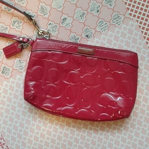 Coach pink patent leather wristlet